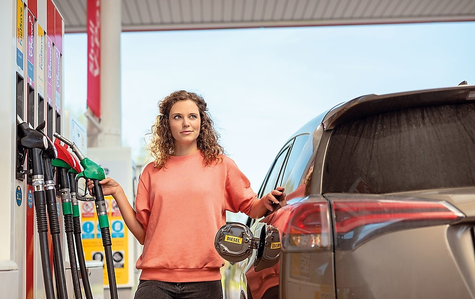 Women standing at fuel station