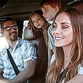 Family driving together in car